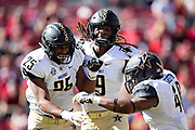 FAYETTEVILLE, AR - OCTOBER 27:  Chris Pierce #19, Josh Smith #25 and Jordan Griffin #40 of the Vanderbilt Commodores celebrates after a big play during a game against the Arkansas Razorbacks at Razorback Stadium on October 27, 2018 in Fayetteville, Arkansas. The Commodores defeated the Razorbacks 45-31.  (Photo by Wesley Hitt/Getty Images) *** Local Caption *** Chris Pierce; Jordan Griffin; Josh Smith