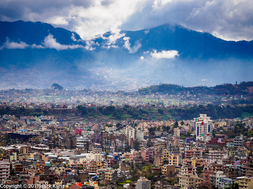 11 MARCH 2017 - KATHMANDU, NEPAL:  The view of Kathmandu after a rainstorm from Swayambhu Stupa. The second most important Buddhist stupa in Kathmandu, Swayambhu Stupa is also a historic landmark and has panoramic views of Kathmandu. It is sacred to both Buddhists and Hindus. The stupa is being rebuilt because it was badly damaged in the 2015 earthquake.   PHOTO BY JACK KURTZ