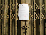 26 FEBRUARY 2016 - BANGKOK, THAILAND: An eviction notice taped to the door of a shophouse in the Verng Nakorn Kasem neighborhood. Verng Nakorn Kasem, also known as the Thieves' Market, was one of Bangkok's most famous shopping districts. It is located on the north edge of Bangkok's Chinatown district, it grew into Bangkok's district for buying and selling musical instruments. The family that owned the land recently sold it and the new owners want to redevelop the famous area and turn it into a shopping mall. The new owners have started evicting existing lease holders and many of the shops have closed. The remaining shops expect to be evicted by the end of 2016.      PHOTO BY JACK KURTZ