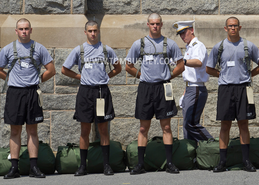 West Point, New York - A cadet checks new cadets during Reception Day at the United States Military Academy at West Point on July 2, 2014. About 1,200 cadet candidates, the West Point Class of 2018, reported to the academy to begin their military careers by getting lessons in marching, military courtesy and discipline.