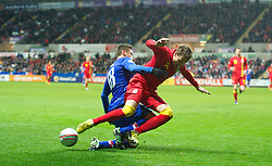 SWANSEA, WALES - Tuesday, March 26, 2013: Wales' Chris Gunter in action against Croatia's Ivica Olic during the 2014 FIFA World Cup Brazil Qualifying Group A match at the Liberty Stadium. (Pic by David Rawcliffe/Propaganda)