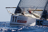 Bigamist 6 (11) and Tau Ceramica-Andalucia during the practice race of the AUDI Medcup in Cartagena