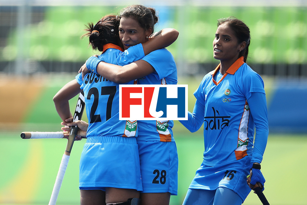 RIO DE JANEIRO, BRAZIL - AUGUST 07:  Sushila Pukhrambam, Rani and Vandana Katariya of India celebrate Rani scoring a goal during the women's pool B match between Japan and India on Day 2 of the Rio 2016 Olympic Games at the Olympic Hockey Centre on August 7, 2016 in Rio de Janeiro, Brazil.  (Photo by Mark Kolbe/Getty Images)