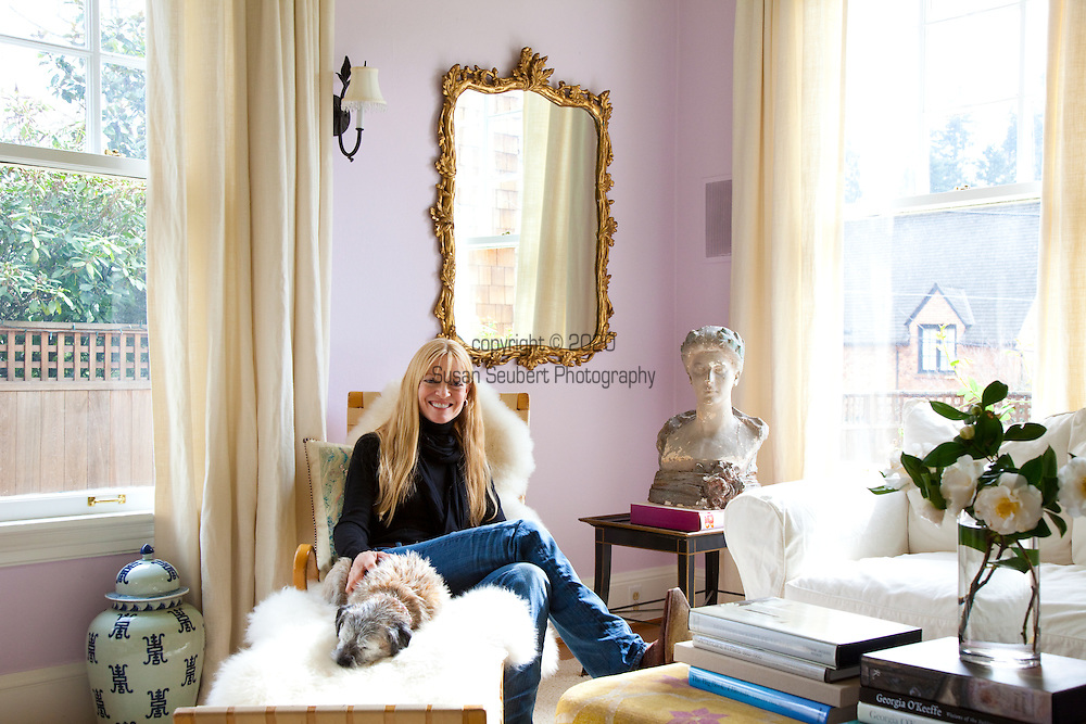 """The Portland, Oregon home of Wendy Burden, author of  the memoir, Dead End Gene Pool. Ms. Burden in her living room, seated on a Bruno Mathesson chaise.  The bust is by William Ordway Partridge, her great-grandfather (on her father's side).  Her dog, """"Spit,"""" is with her."""