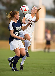 Virginia Cavaliers midfielder/forward Caitlin Miskel (7) wins a header from Georgetown Hoyas defender Norah Swanson (20).  The #6 Virginia Cavaliers played the Georgetown Hoyas to a 2-2 draw in a NCAA Women's Soccer pre-season exhibition game held at Klockner Stadium on the Grounds of the University of Virginia in Charlottesville, VA on August 18, 2008.