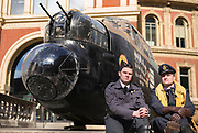 UNITED KINGDOM, London: 26 February 2018 <br /> WWII re-enactors sit in front of a 23 foot Lancaster Bomber replica in front of The Royal Albert Hall this morning to mark the 75th anniversary since 'Operation Chastise' was given final approval. It also comes before a gala screening of The Dam Busters which will be shown in May to make the occasion.<br /> Photograph: Rick Findler