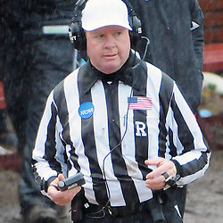 Staff photos by Tom Kelly IV<br /> The head referee listens to the replay booth, after a roughing the kicker penalty was called against West Chester on a punt.  The call was not reversed, during the West Chester University at Lenoir-Rhyne University (Hickory, NC) NCAA Division II semifinal game, Saturday December 14, 2013.  WCU lost by a score of 42-14.