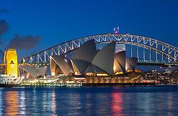 Night view of Sydney Opera House and Harbour Bridge in Sydney Australia