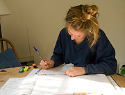 Model Released picture of seventeen year old teenage girl studying revising for exams
