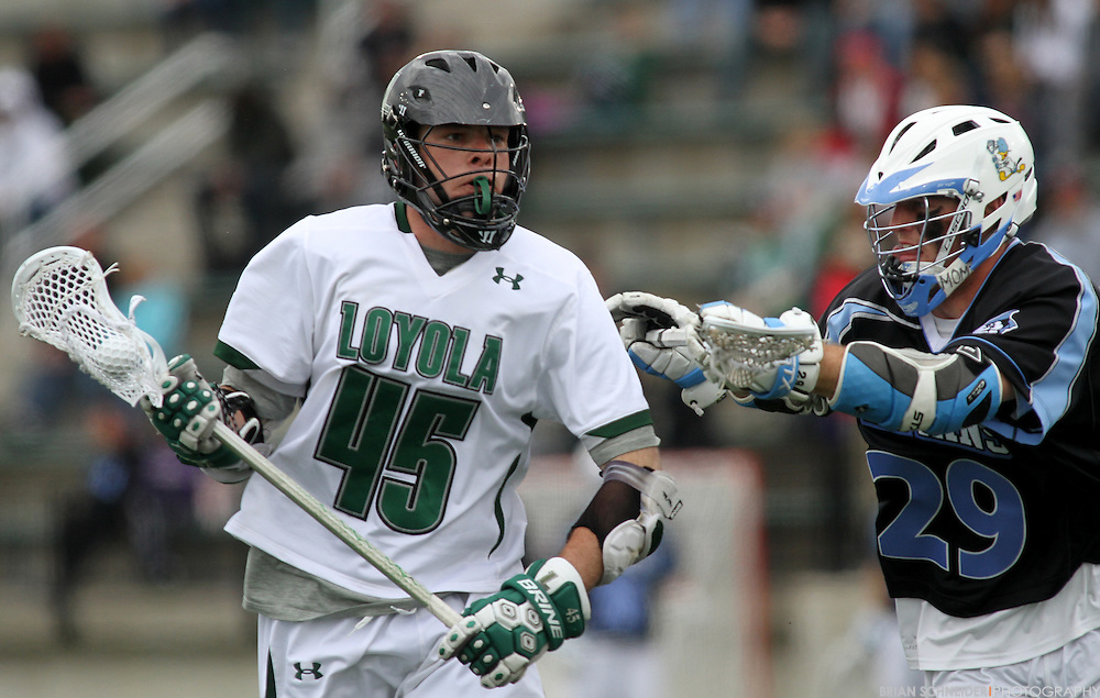 April 28, 2012; Baltimore, MD, USA; Loyola Greyhounds midfielder J.P. Dalton (45) makes a run against Johns Hopkins Blue Jays midfielder Mike Poppleton (29) at  Ridley Athletic Complex in Baltimore, MD. Mandatory Credit: Brian Schneider-www.ebrianschneider.com