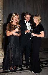 Left to right, KATE BOSTOCK, STUART ROSE and news reader KIRSTY YOUNG at the 2004 British Fashion Awards held at Thhe V&A museum, London on 2nd November 2004.<br />