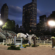 Richie Moloney, Ireland, riding Freestyle De Muze, in action during the $210,000 Central Park Show Jumping Grand Prix held in the Wollman Ice Rink. The event was part of the four Day Central Park Horse Show. Central Park, Manhattan, New York, USA. 18th September 2014. Photo Tim Clayton
