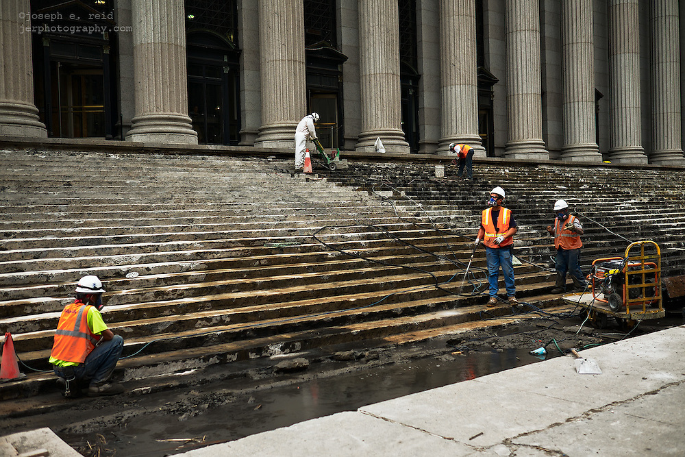 Workers on the steps of the James Farley post office building, New York, NY, US