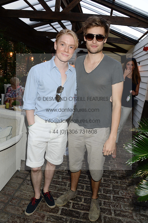 Left to right, FREDDIE FOX and DOUGLAS BOOTH attending the Warner Bros. & Esquire Summer Party held at Shoreditch House, Ebor Street, London E1 on 18th July 2013.