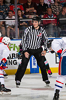 KELOWNA, BC - SEPTEMBER 21:   Linesman Josh Albinati prepares to drop the puck between the Spokane Chiefs and the Kelowna Rockets at Prospera Place on September 21, 2019 in Kelowna, Canada. (Photo by Marissa Baecker/Shoot the Breeze)