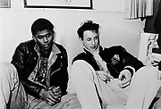 Two guys hanging out at a squat party, Kings Cross, London 1987
