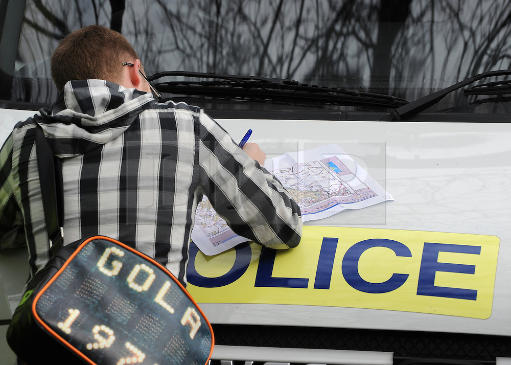 ©London News pictures. 22/03/11.  A volunteer writes on a map of the search area. Locals and friends of Sian O'Callaghan help Police in the search in Savernake Wood, Wiltshire, today. Detectives continue investigating the disappearance of office administrator Sian O'Callaghan. The 22-year-old disappeared after leaving Suju nightclub in Swindon at about 2.50am on Saturday to walk the half-mile home to the flat she shared with her boyfriend Kevin Reape. Picture Credit should read Stephen Simpson/LNP