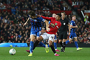 Rochdale's Jordan Williams holds off Manchester United's Jesse Lingard during the EFL Cup match between Manchester United and Rochdale at Old Trafford, Manchester, England on 25 September 2019.