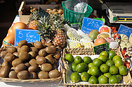 Kiwi , limes, pineapple, mangos for sale in a french market