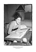 Heraldic artist Myra Maguire at work in the Genealogical Office in Dublin Castle <br />