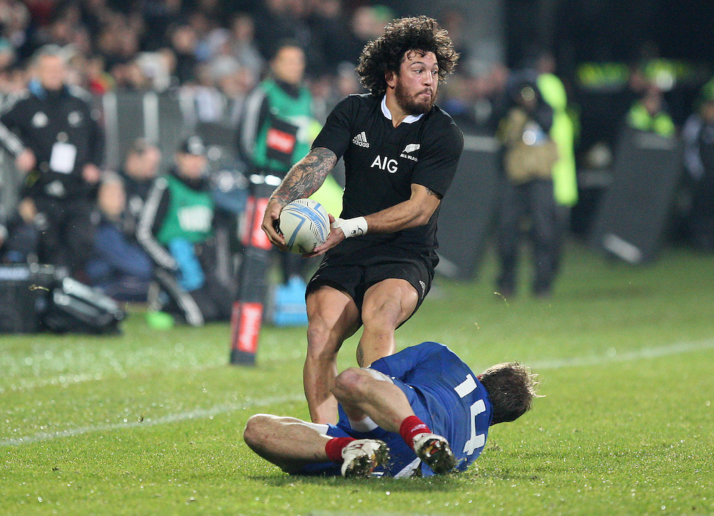 New Zealand's Rene Ranger in the tackle of France's Adrien Plante in the second International rugby test match, AMI Stadium, Christchurch, New Zealand, Saturday, June 15, 2013. Credit:SNPA / Dianne Manson.