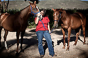 Tessa Kuret - age 36 - Tessa contracts to Montrose as the Equine Therapist and is pictured here with her horses Winni and Trigger, 27 December 2011.Equine assisted therapy at De Grendel farm Cape Town, through the Montrose clinic and foundation.The clinic treats patients with addiction illnesses such as alcoholism and eating disorders and the foundation is a charity that helps with street children from the townships..              .
