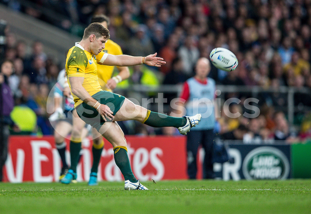 Bernard Foley of Australia clears during the Rugby World Cup Quarter Final match between Australia and Scotland played at Twickenham Stadium, London on the 18th of October 2015. Photo by Liam McAvoy.