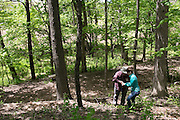 Jamie Buss and Greg Langen of Pittsford go geocaching in Pittsford on Wednesday, May 18, 2016.