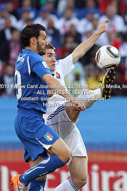 24 JUN 2010:  Jan Kozak (SVK)(right behind) gets his foot on the ball as Gianluca Zambrotta (ITA)(19) applies pressure.  The Slovakia National Team led the Italy National Team 1-0 at half time at Ellis Park Stadium in Johannesburg, South Africa in a 2010 FIFA World Cup Group F match.