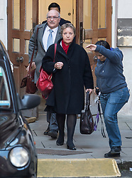 © Licensed to London News Pictures. 12/02/2018. London, UK. A member of staff attempts to block photographers as Oxfam CEO, Mark Goldring and Caroline Thomson, chair of Oxfam, leave the Department for International Development following a meeting with Secretary of State for International Development Penny Mordaunt to discuss claims of sexual misconduct by its aid workers. Mordaunt wants to hear more from Oxfam about allegations its staff used prostitutes in Haiti in 2011. Photo credit: Ben Cawthra/LNP