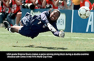 USA Womens Soccer Team goaltender Briana Scurry blocks a shot by China during the double overtime shootout of the FIFA Women's World Cup Championship to win the final game.