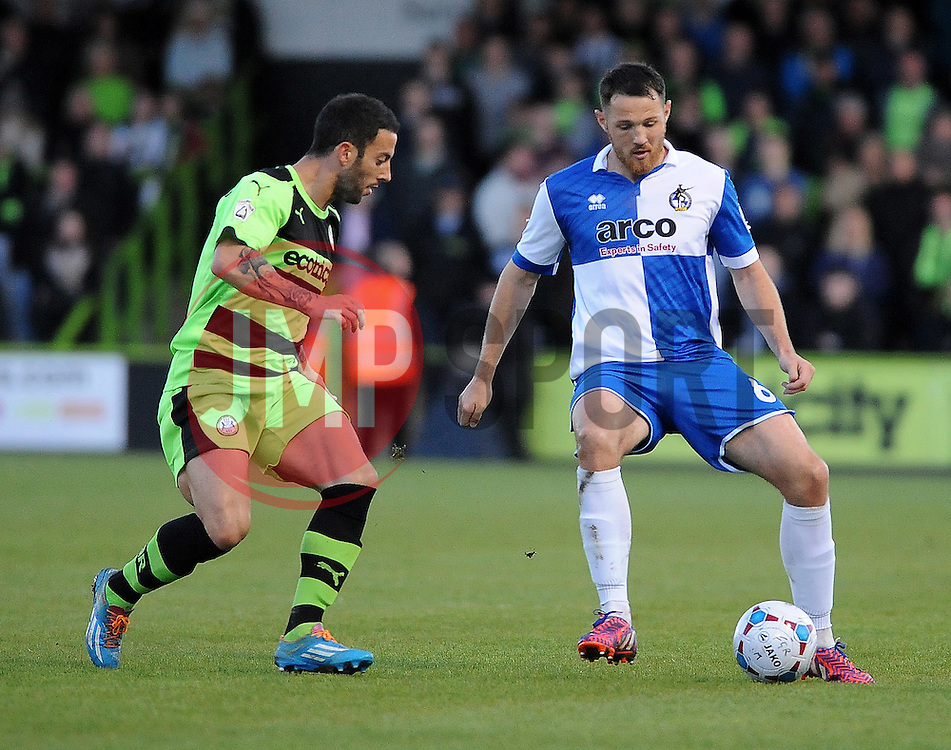Bristol Rovers' Tom Parkes is challenged by Forest Green Rovers's Stuart Fleetwood  - Photo mandatory by-line: Neil Brookman/JMP - Mobile: 07966 386802 - 29/04/2015 - SPORT - Football - Nailsworth - The New Lawn - Forest Green Rovers v Bristol Rovers - Vanarama Football Conference