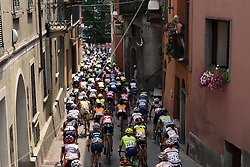 Peloton weave through the narrow streets on the first of three laps at the final stage of the Giro Rosa 2016 on 10th July 2016. A 104km road race starting and finishing in Verbania, Italy.