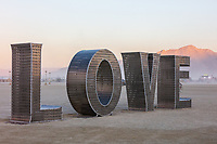 LOVE<br /> by: Laura Kimpton with Jeff Schomberg<br /> from: Venice, CA and Reno, NV<br /> year: 2019<br /> <br /> Rainbow LOVE is celebration of love — reminding us that everyone should have the right to love who they love, and to love themselves.<br /> <br /> https://burningman.org/event/brc/2019-art-installations/?yyyy=&artType=B#a2I0V000001TAJuUAO