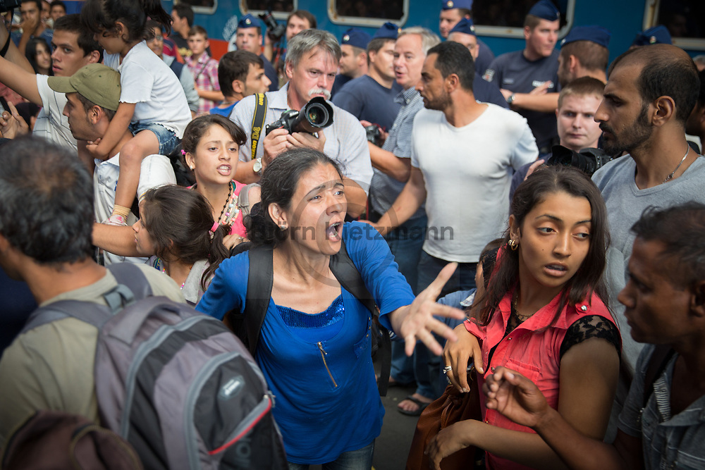 Budapest, Hungary - 01.09.2015<br /> <br /> Police clears the East Station in Budapest. Trains do not leave anymore. The day before, many refugees were given the opportunity to buy train tickets to Germany and Austria - they are now stuck in Budapest again, despite the tickets they are not allowed to use the trains. For some days the station resembles a refugee camp.<br /> <br /> Polizei r&auml;umt den Ostbahnhof in Budapest. Z&uuml;ge fahren nicht mehr ab. Nachdem am Vortag viele Fluechtlinge die Moeglichkeit bekamen Zugtickets nach Deutschland und Oesterreich zu kaufen - stecken diese nun wieder in Budapest fest, trotz Fahrkarten duerfen sie nun erneut keine Zuege benutzen. Seit einigen Tagen gleicht der Bahnhof einem Fluechtlingscamp.<br /> <br /> Photo: Bjoern Kietzmann