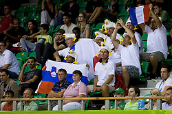 Fans of team France with Slovenian flag during basketball match between National teams of France and Great Britain at Day 2 of Eurobasket 2013 on September 5, 2013 in Tivoli Hall, Ljubljana, Slovenia. (Photo By Urban Urbanc / Sportida )