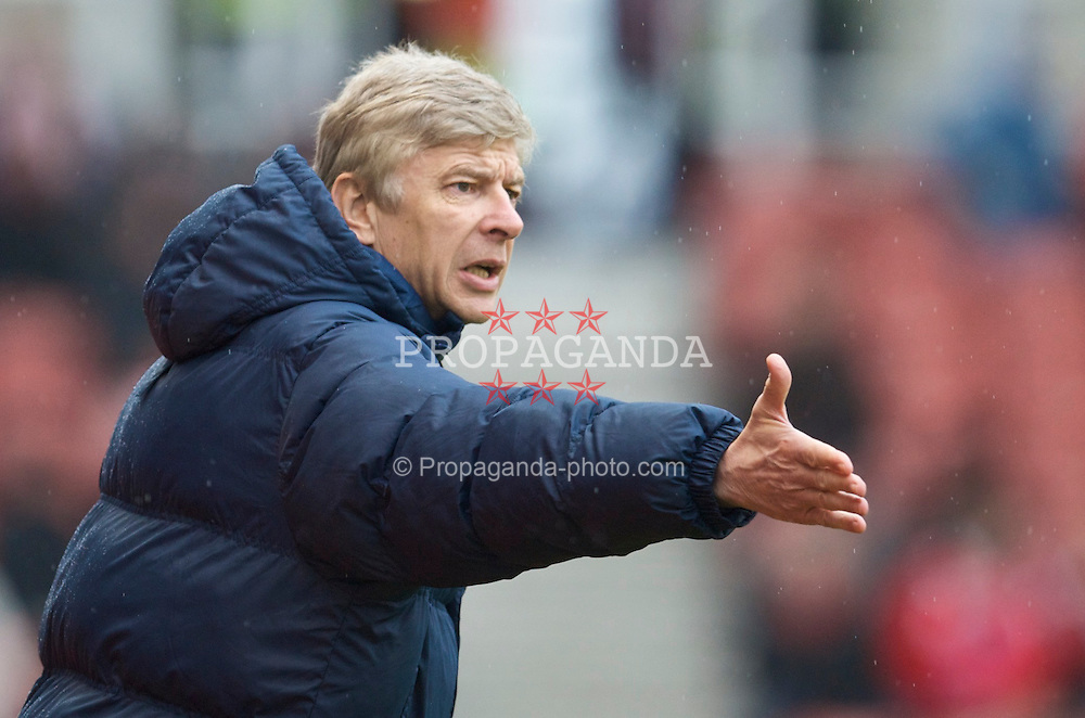 STOKE, ENGLAND - Sunday, January 24, 2010: Arsenal's manager Arsene Wenger during the FA Cup 4th Round match against Stoke City at the Britannia Stadium. (Photo by David Rawcliffe/Propaganda)