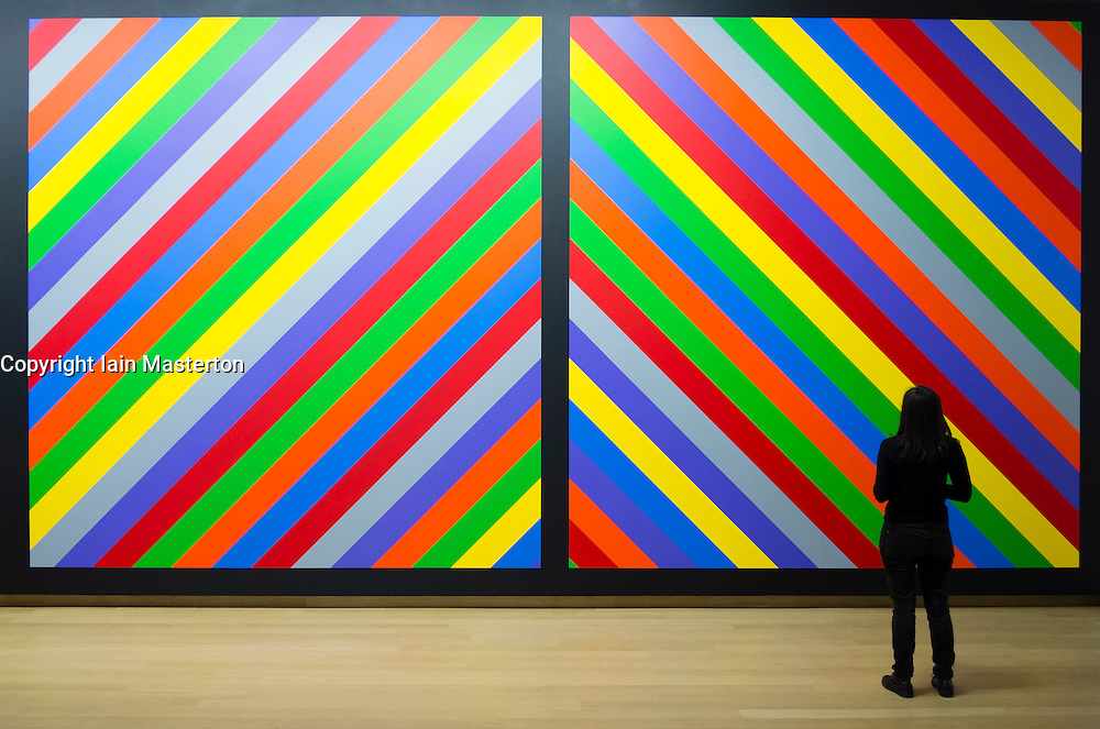 Woman looking at painting Wall Drawing #1084 by Sol Lewitt at  Stedelijk Museum of contemporary art in Amsterdam The Netherlands