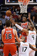 Nov 18, 2015; Phoenix, AZ, USA; Chicago Bulls guard Jimmy Butler (21) makes a pass through the Phoenix Suns center Tyson Chandler (4) and forward P.J. Tucker (17) in the first half of the NBA game at Talking Stick Resort Arena. Mandatory Credit: Jennifer Stewart-USA TODAY Sports