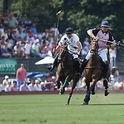 Kris Kampsen, (right), K.I.G. moves in to score while challenged by Hilario Ulloa, (left), White Birch during the White Birch Vs K.I.G Polo match in the Butler Handicap Tournament match at the Greenwich Polo Club. White Birch won the game 11-8. Greenwich Polo Club,  Greenwich, Connecticut, USA. 12th July 2015. Photo Tim Clayton