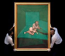 "© licensed to London News Pictures. London, UK  17/06/2011. Sotheby's workers hold ""Crouching Nude' by Francis Bacon,which is estimated to fetch  up to £9 million at auction as part of Sotheby's upcoming auction of Modern art. Please see special instructions for usage rates. Photo credit should read Ben Cawthra/LNP"