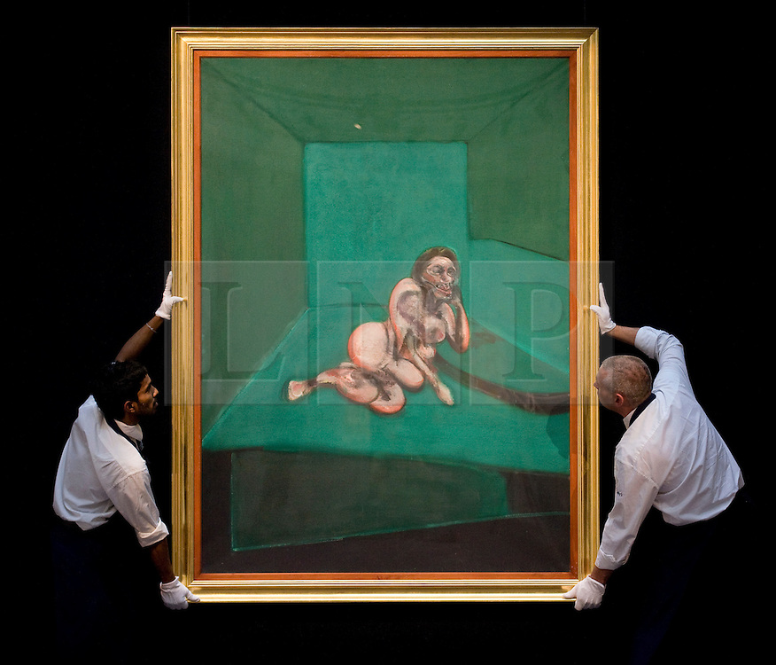 """© licensed to London News Pictures. London, UK  17/06/2011. Sotheby's workers hold """"Crouching Nude' by Francis Bacon,which is estimated to fetch  up to £9 million at auction as part of Sotheby's upcoming auction of Modern art. Please see special instructions for usage rates. Photo credit should read Ben Cawthra/LNP"""