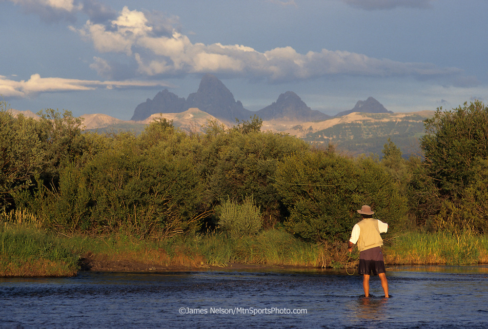 08239-B. An angler casts a fly for trout on east Idaho's Teton River, with the Teton Range of Wyoming in the background.