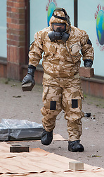 © Licensed to London News Pictures. 24/04/2018. Salisbury, UK. A member of the armed forces removes bricks from the  Maltings where a bench was earlier removed as the cleanup operation begins in Salisbury. Former Russian Spy Sergei Skripal and his daughter Yulia were poisoned using a nerve agent in the city last month. Experts have warned that 'Toxic levels' of the nerve agent novichok could still be present at hot spots around the city. Photo credit: Peter Macdiarmid/LNP