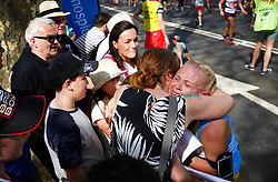 © Licensed to London News Pictures. 22/04/2018. London, UK. A runner is greeted by friends during the 2018 London Marathon which is being run in unusually warm temperatures for April. This years event is being started by HRH Queen Elizabeth II. Photo credit: Tom Nicholson/LNP
