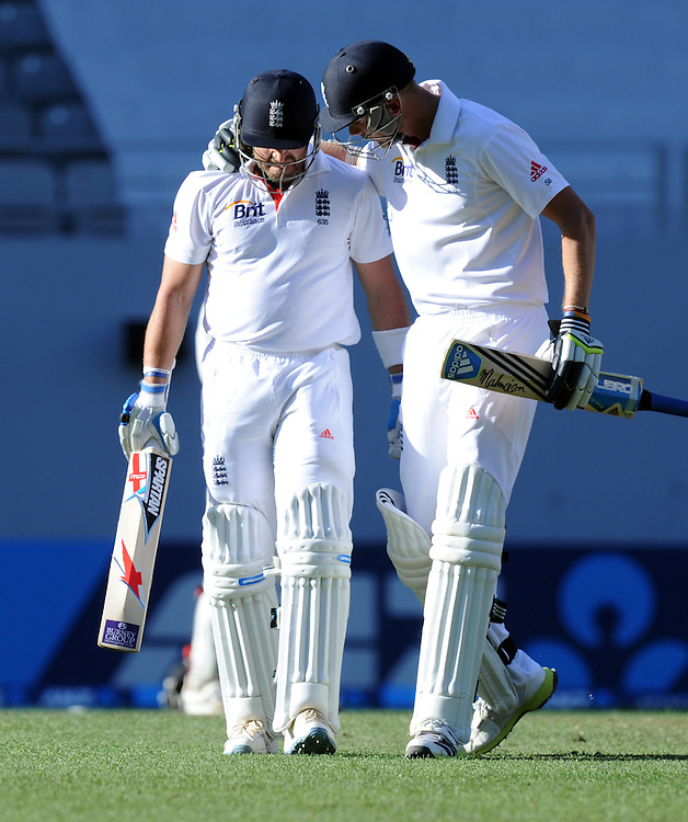 England's Matt Prior, left, is congratulated by Stuart Broad after soring a century against New Zealand on the fifth day of the 3rd international cricket test, Eden Park, Auckland, New Zealand, Tuesday, March 26, 2013. Credit:SNPA / Ross Setford