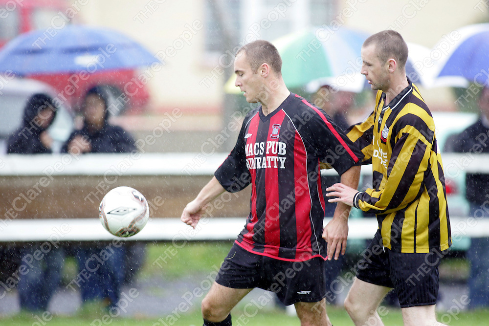 Bunratty's Trevor Twoomey takes on Sixmilebridge's Nigel Quene in thier meeting in Sixmilebridge on Sunday. Pic. Brian Arthur/ Press 22.