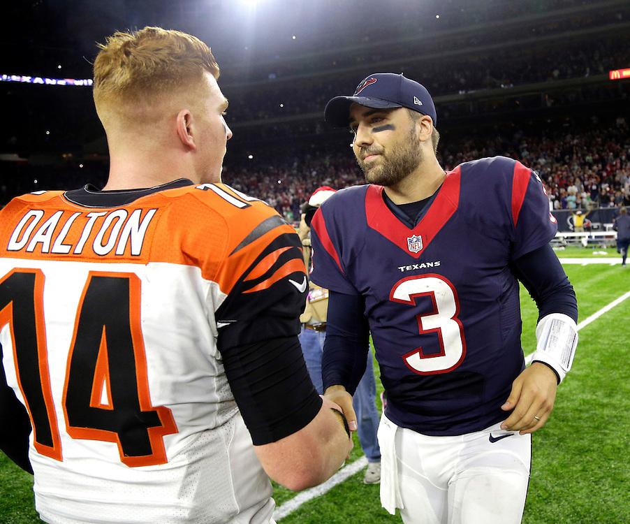 Houston Texans quarterback Tom Savage (3) greets Cincinnati Bengals quarterback Andy Dalton (14) after an NFL football game Saturday, Dec. 24, 2016, in Houston. The Texans won 12-10. (AP Photo/Sam Craft)