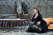 "Evaggelia Drougia resting next to ""nerotrivi"", the village water whirl for washing clothes and carpets and freshens her self up with the cold mountain water. She lives and works in the nearby city Ioannina but comes to the village to see her parents and friends almost every weekend. SHe grew up in teh village and deeply cares for it."