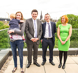 Pictured:  Claire Maclean (Senior Solicitor) and her three year old son Jack, Jamie Hepburn, and Alan Delaeny, Director and Amanda Jones, Partner and Head of Dispute,<br /> <br /> Employment Minister Jamie Hepburn visited Maclay Murray and Spens today as the latest unemployment figures were released. Mr Hepburn met employees who have benefited from family-friendly working policies. He was welcomed to Quatermile One by Amanda Jones, Partner and Head of Dispute, Claire Maclean (Senior Solicitor) and her three year old son Jack, and Alan Delaeny, Director<br /> of Employment, Pensions and Immigration.<br /> Ger Harley | EEm 14 June  2017